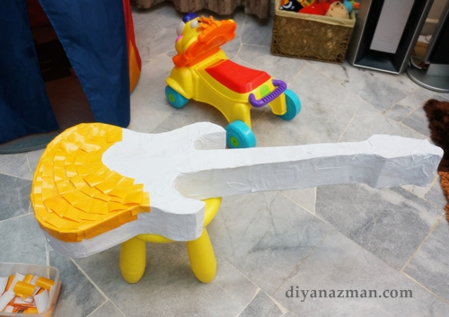 yellow pinata guitar for party